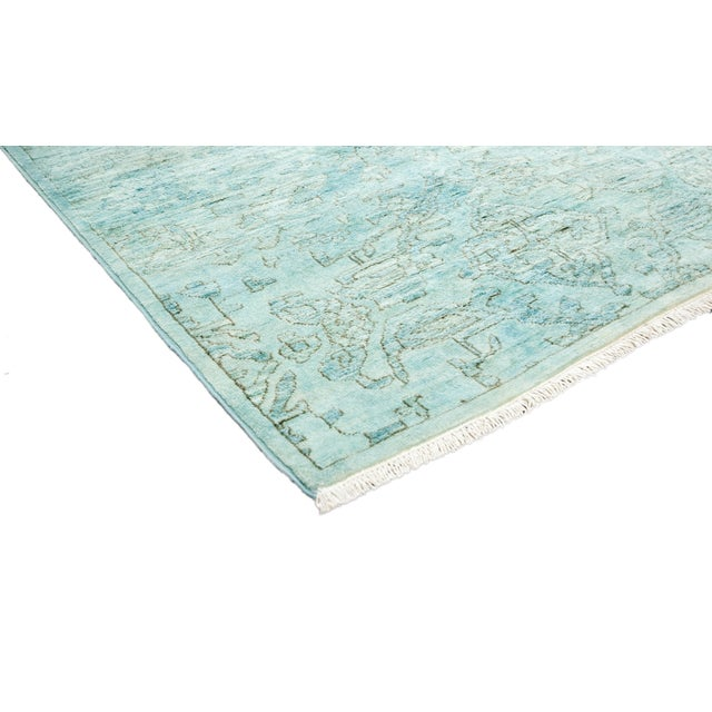 Made in Pakistan. In saturated, all-over dyes, these hand-knotted rugs have modern vibrancy. Originally a Moroccan,...