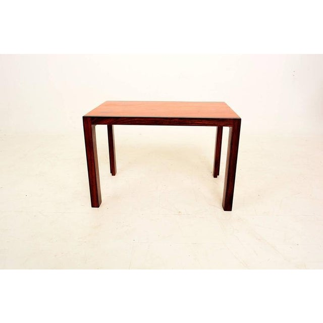 For your consideration a solid wood side table. Beautiful grain. the side and legs are solid rosewood. The top appears to...