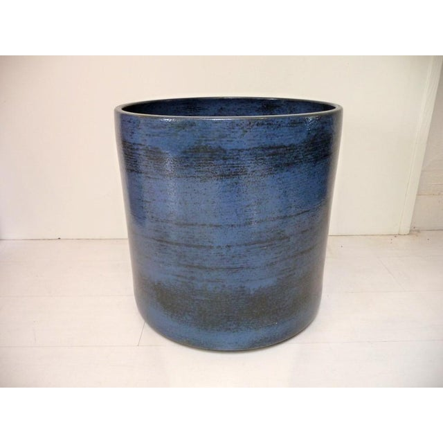 This large Gainey Ceramics planter is done in a beautiful, deep blue. The planter has no drainage holes and is signed on...