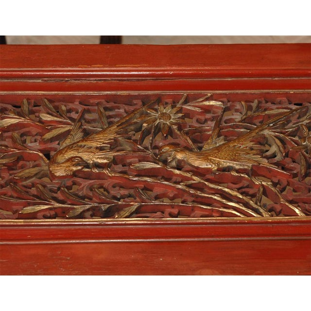 Red lacquered Chinese coffee tables incorporating late 19th Century intricately carved and gilt wood panels. They would be...