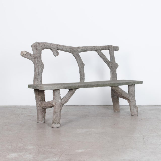 "This concrete bench originates from France, c. 1970. A rustic branched seat back, in impressive ""fake wood"", executed in..."