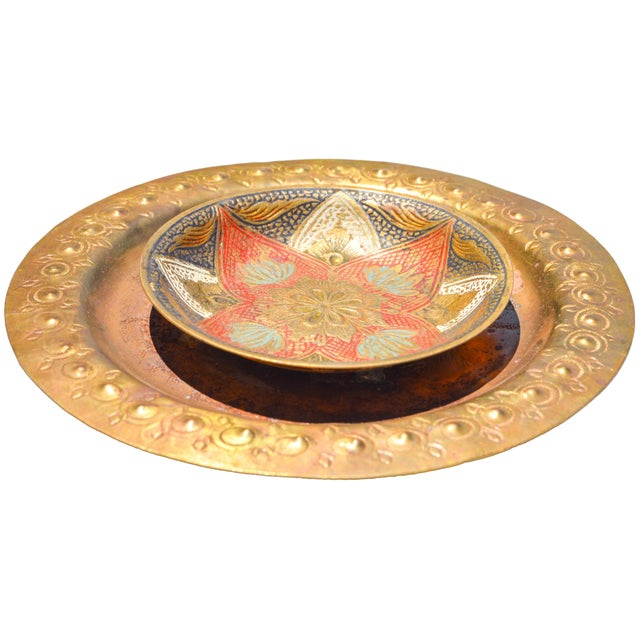 Brass dish with ornate details handmade in Morocco. Hook on back for wall display.
