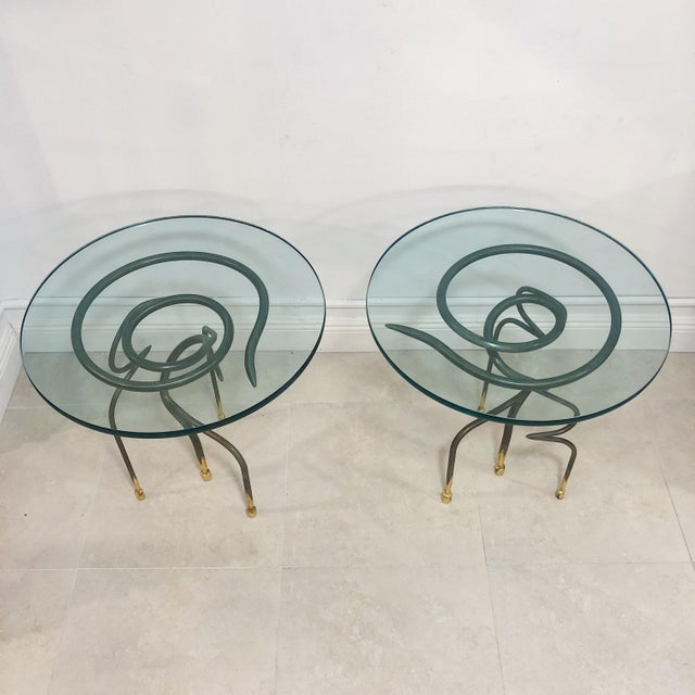 A stunning pair of studio made raw steel sculptural end tables. They have a post modern twist and angles and closely...