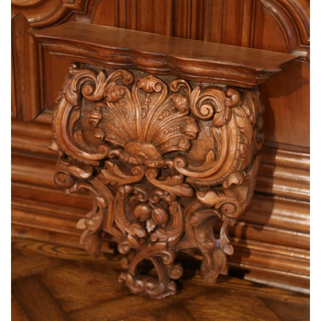 Place a bust or a vase on this elegant antique wall corbel; crafted in France of solid walnut wood, circa 1860, the large...