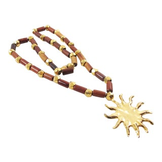 Edouard Rambaud Paris Long Necklace Wood Gilt Metal Sun Medallion For Sale