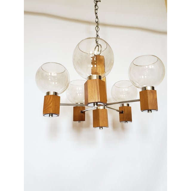 Mid Century Modern teak wood and chrome Danish chandelier. 5 smoke glass shades seat securely each arms, very nice example...