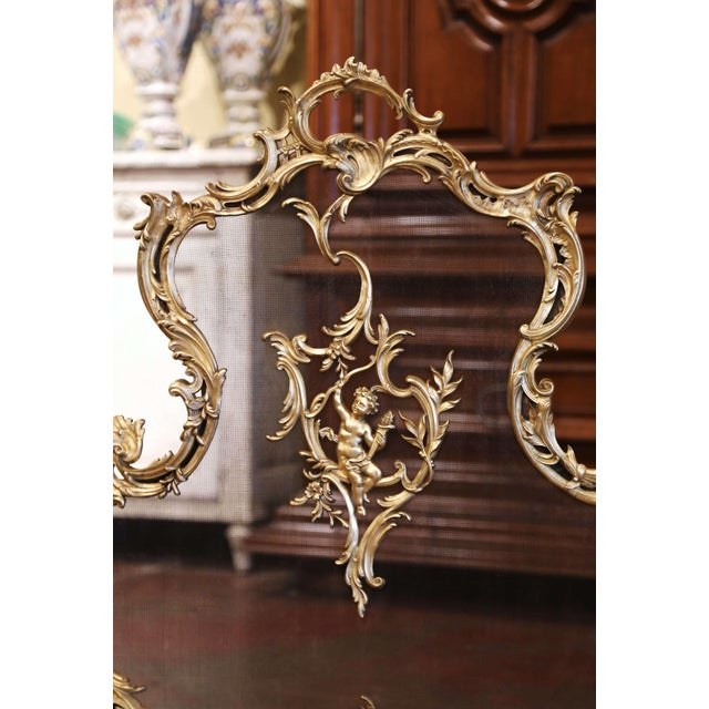 Decorate a fireplace with this elegant antique screen. Crafted in France circa 1870 and made of bronze, the shaped screen...
