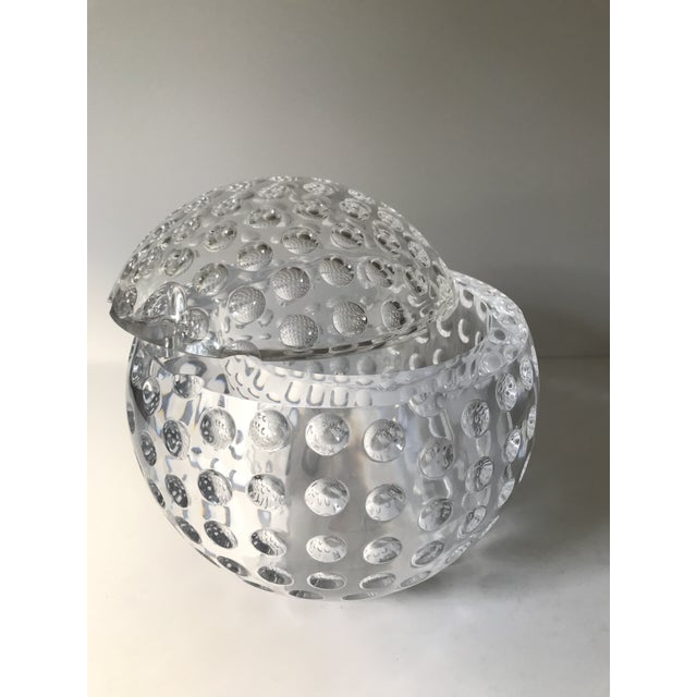 Mario Luca Giusti style lucite / acrylic ice bucket has a fixed hinged lid. Lid swivels to open. Would also look bonkers...