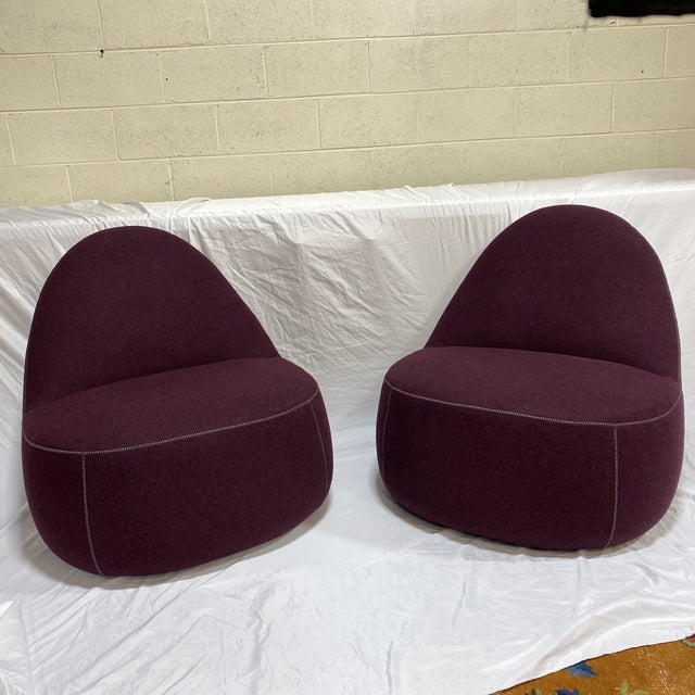 Fantastic pair of Bernhardt club chairs on casters in a plum colored wool fabric and baseball stitch. These were in a...