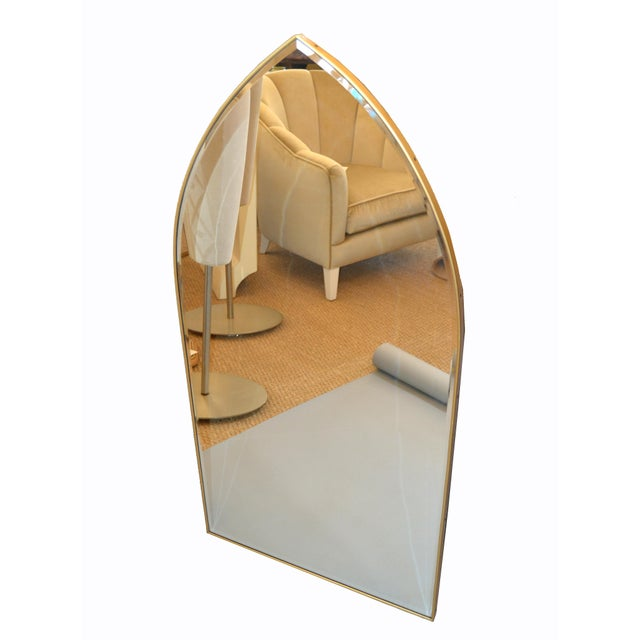 Large Hollywood Regency Gothic Arch Wall Mirror from Italy. The Mirror is beveled and framed with Brass. This stunning...