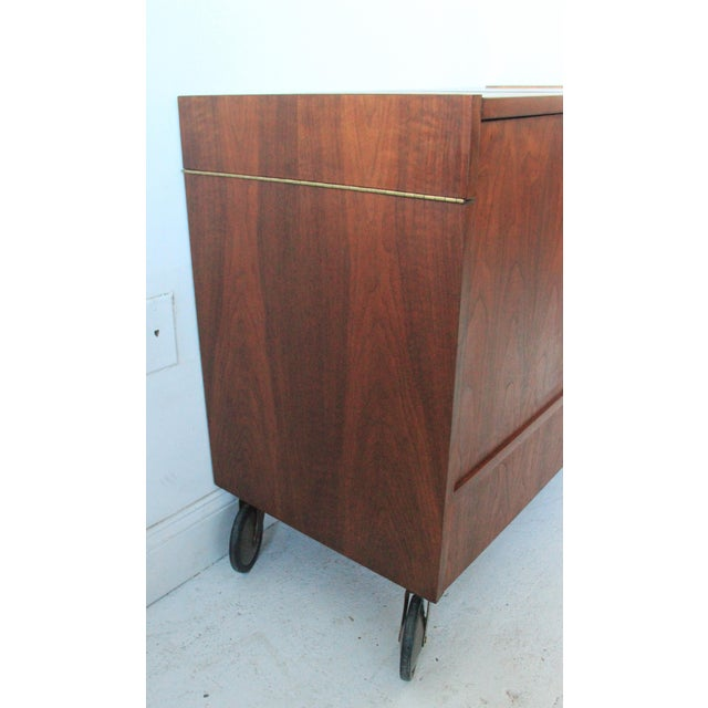 Vintage Mid Century Modern Side Bar Cabinet Danish inspired design with rolling castors Top opens up with space on each...
