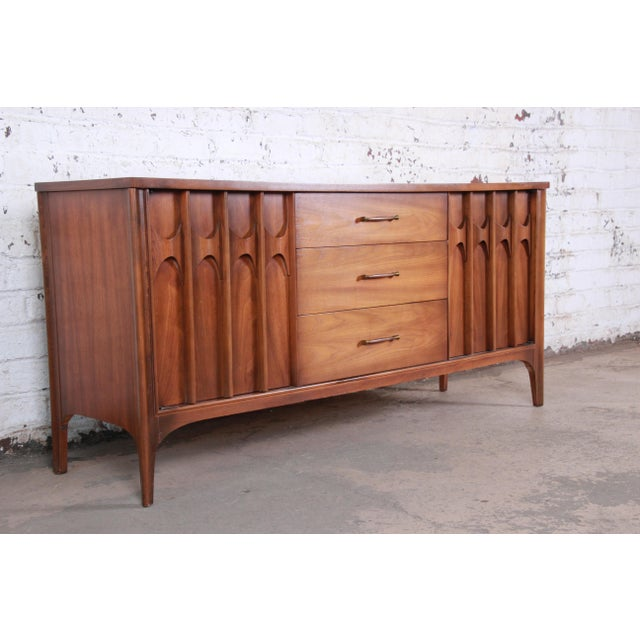 A gorgeous mid-century modern credenza or sideboard from the Perspecta line by Kent Coffey. The credenza features stunning...