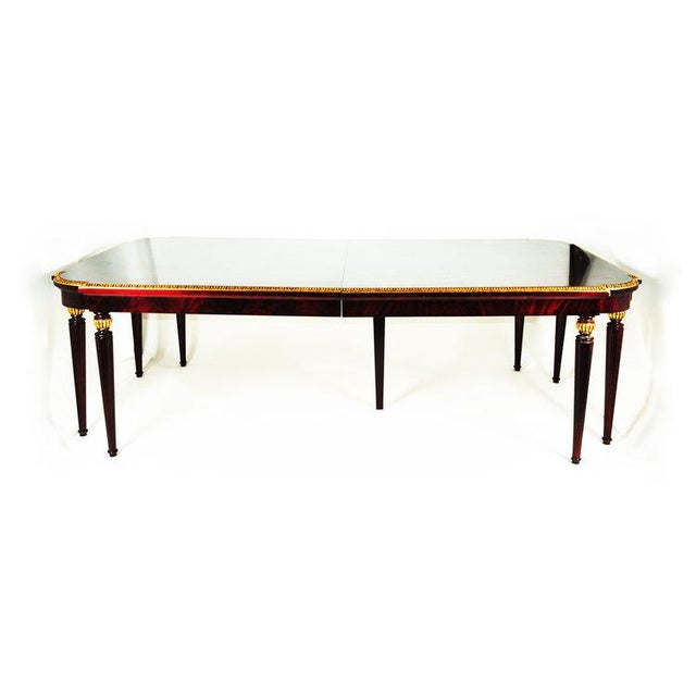 Exquisite French vintage mahogany wood dining table with beautifully hand-carved, 24-karat gold leaf border design...