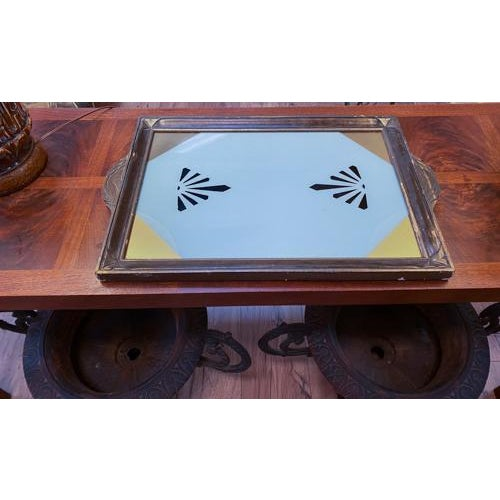 Art Deco details plus a blast of color. This wood tray holds a reverse painted piece of glass. Painted with blue, gold and...