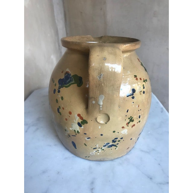 Large splatter paint pitcher from the Savoie region of France made between 1880-1920. Jaspe pottery is typically marble-...