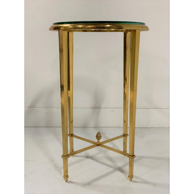 French Gilt Bronze and Glass Side Gueridon Table. Nice French side table with tapered legs with a pineapple finial to the...