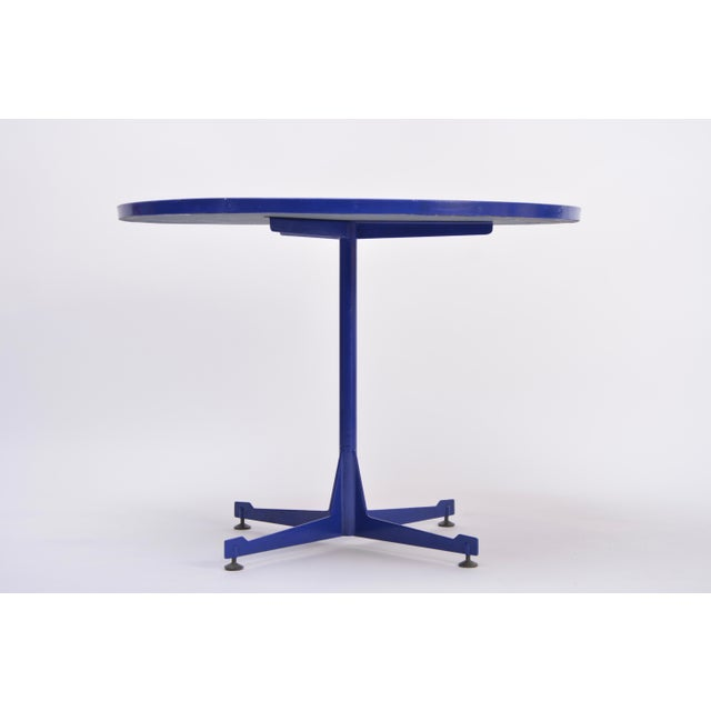 The unusual dining table was produced in Italy in the 1950s. The top is made of enameled copper, the base is made of...