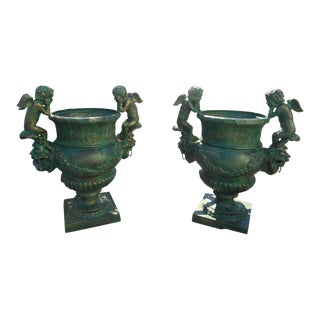 Amazing Pair of Cast Iron Urns With Cherubs on the Sides For Sale