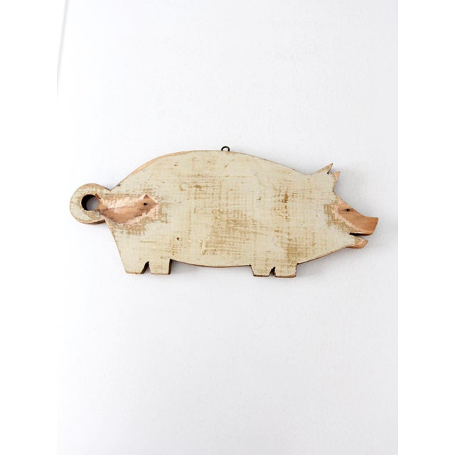 This is a vintage wooden pig cutting board. Perfect for a farmhouse kitchen or someone who adores piggies. The pig-shaped...