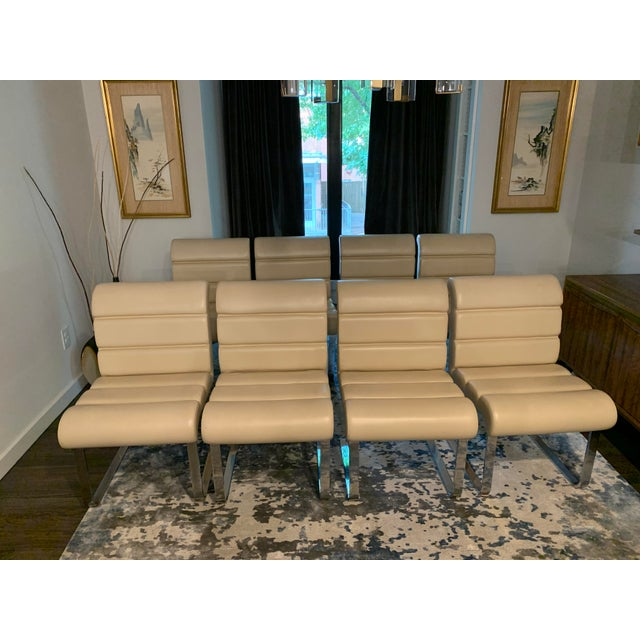 Elegant set of eight Mariani Laguna Pace Collection cantilevered chrome dining chairs. The Italian midcentury modern...