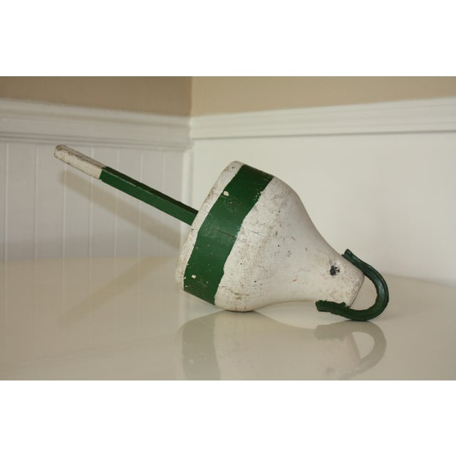An authentic vintage wooden lobster float or nautical buoy. It features the original white paint with green painted...