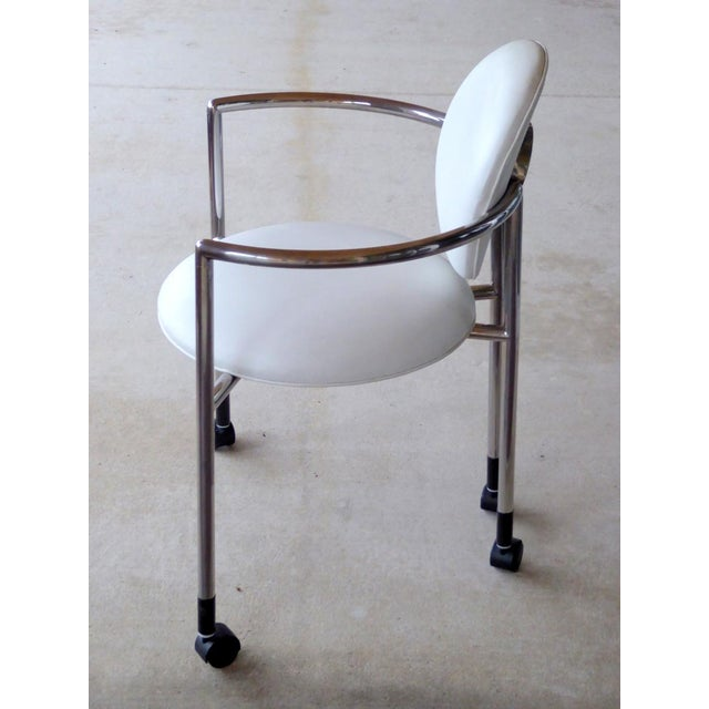 A stunningly elegant moon rolling desk chair by Stanley Jay Friedman for Brueton in pure white and chrome-plated steel...