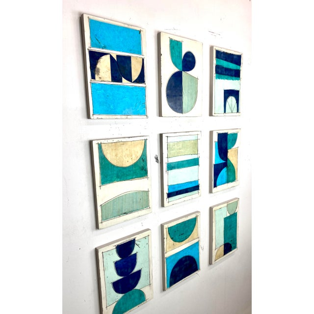 Nine 12x9 cradled wood panels make up this encaustic mixed media art piece. In the photo they are hanging spaced...