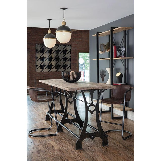 Commanding tradition and style, our Otis Pendant features a bold collaboration of metal and frosted glass—suspended by an...