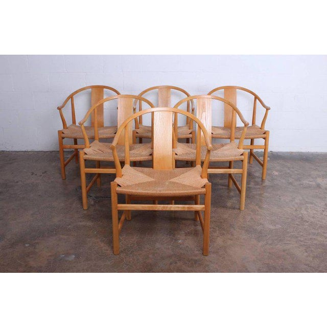 A rare set of six oak Chinese chairs designed by Hans Wegner for PP Mobler.