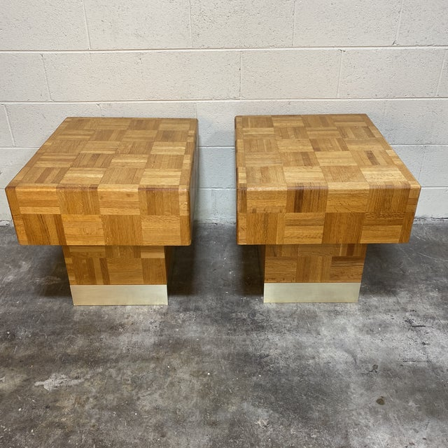Parquetry never gets old. Fantastic pair of end tables with parquetry and brass or goldish colored metal bases. Really...