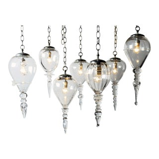 Set of Seven Handblown Glass Pendant Light Fixtures For Sale