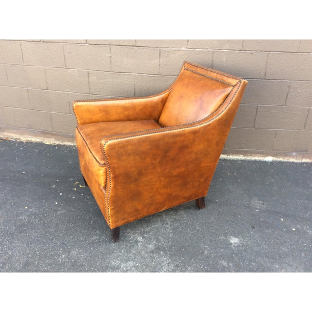 Caramel brown leather club chair with nailhead trim. Leather is thick and rich. Chair was purchased at an estate sale and...