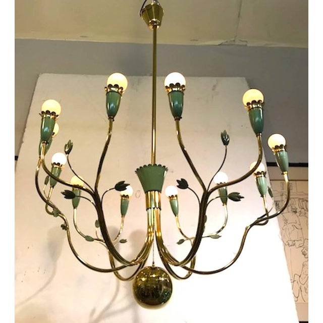 A wonderful and large chandelier designed by Angel Lelli and produced by Arredoluce, circa 1950. Lelli founded the...