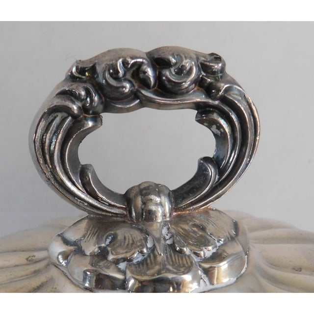 Absolutely fabulous is what you would call this elaborate heavy mid century EPCA Poole Silver Company lidded silver plate...