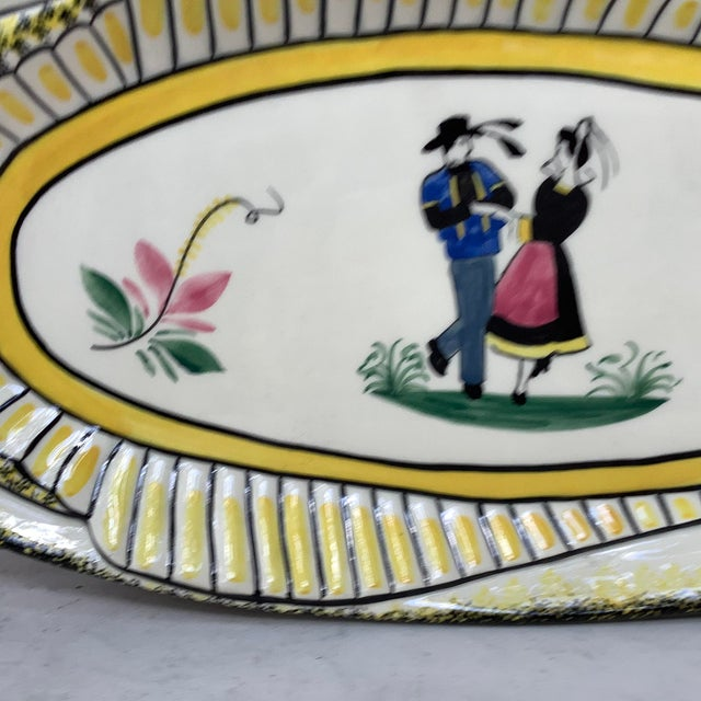 """French faience large oval fish platter signed Henriot Quimper, circa 1940. Measures: 21"""" L on 9.3"""", 9"""" by 8.5""""."""