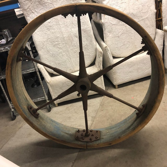 Old large industrial wheel made of wood and iron.