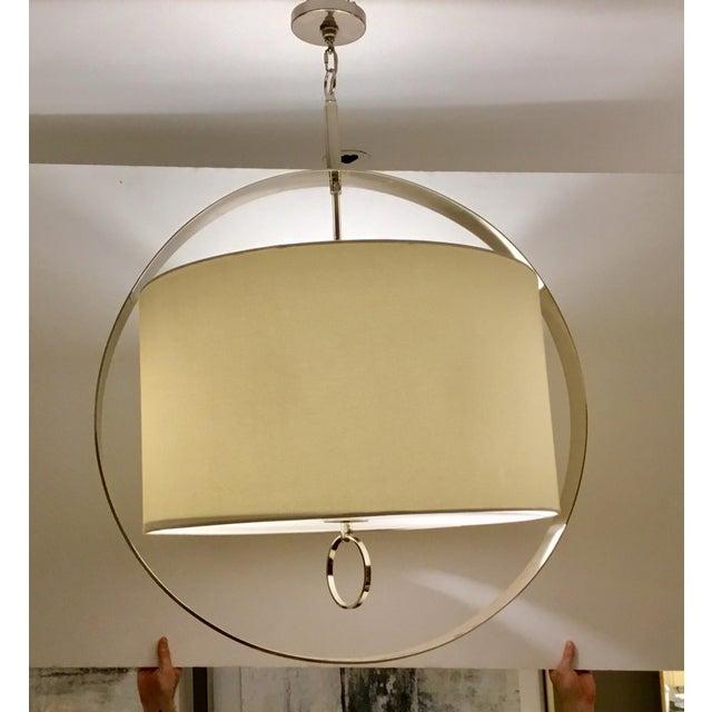 Stylish Regina Andrew Modern Large Drum Shade Polished Nickel Derby Chandelier, white drum shade, showroom floor sample,...