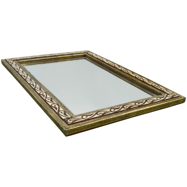 Handcrafted Moroccan mirror with camel bone and brass inlay.