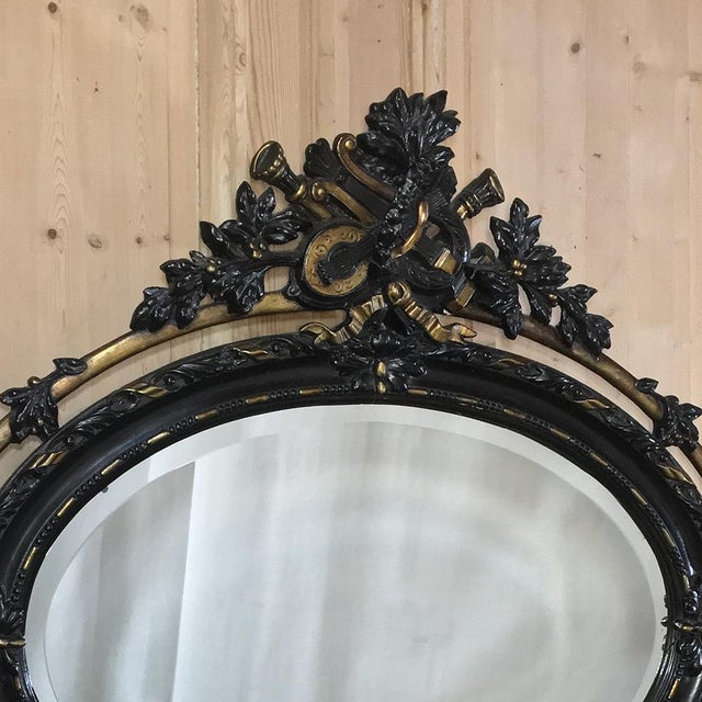 Created in an uncommon horizontally oriented oval shape, this wonderful Antique French 19th Century Louis XVI Oval Mirror...