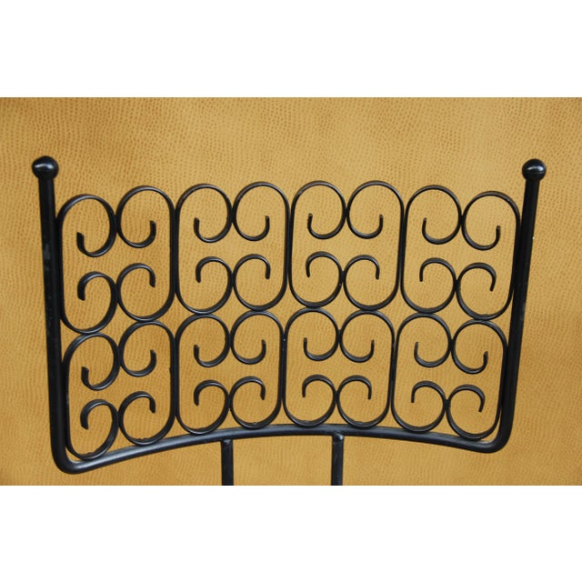 These are almost perfect wrought iron barstool chairs by Arthur Umanoff and they are fabulous. They swivel, too. I found...