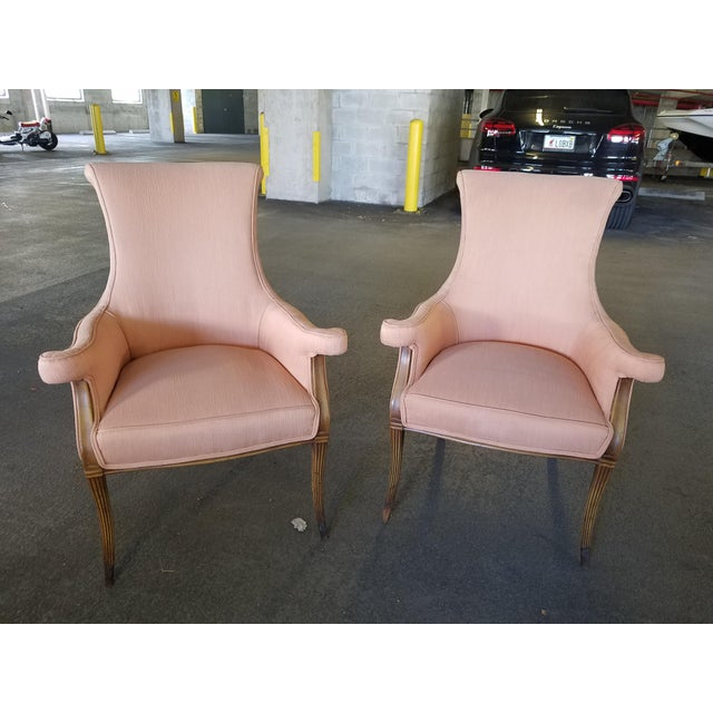 Seductive pair of Hollywood Regency Dorothy Draper style club chairs w brass caps. The pieces date back to the 1940s.