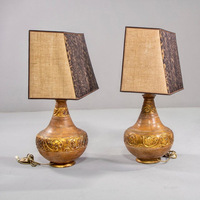 Circa 1970s pair of ceramic Italian lamps feature decorative bands of incised flowers and vines and a warm, Tuscan gold...