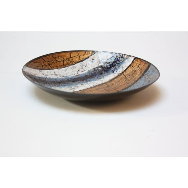 Enamel on copper dish (circa 1960s) with spectacular color and detail. Bands of blue, white, and gold detailed with...