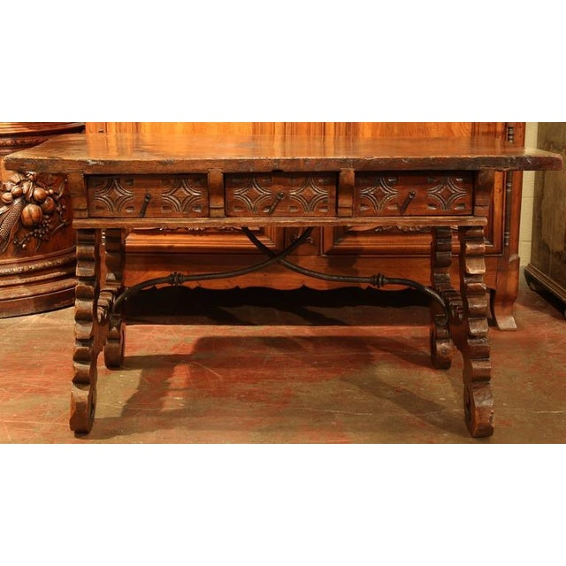 Complete your library or study with this beautiful antique writing table from Spain, circa 1750. The desk features three...