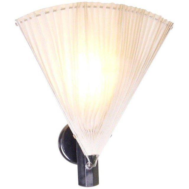 Very rare Scarpa Wall Lamp by Flos. Milk glass diffuser and adjustable fabric shade. Wiring is in good condition, but...