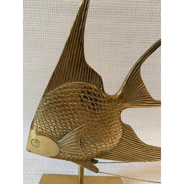 Large and heavy brass sailfish on stand. Great detailing! Would look fantastic on a bookshelf, console table or mantle!
