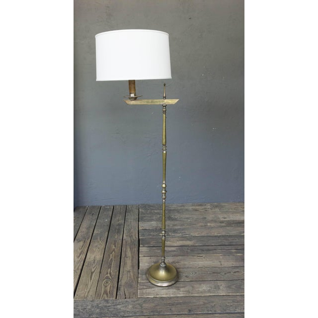 Silvered bronze floor lamp with adjustable arm. Price includes polishing or plating and new wiring. Please allow 2 to 3...