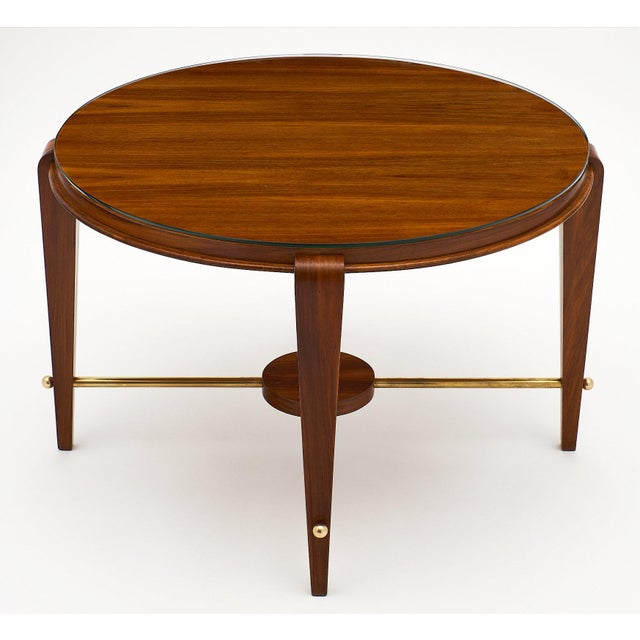 Sleek French Art Deco period walnut gueridon. This piece is made of figured walnut and finished with a lustrous French...