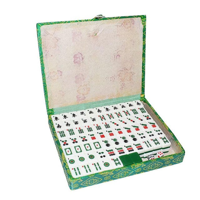 Beautiful vintage Chinese Mahjong set in a green brocade carrying case. A great way to keep family and friends occupied!...