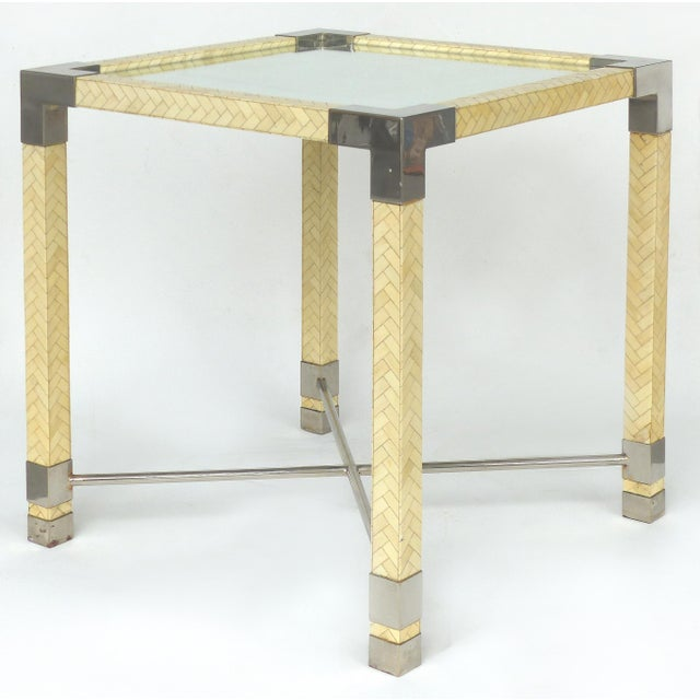 Offered for sale is a Karl Springer Style tessellated bone and chrome game table with a mirrored glass top. The chrome...